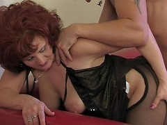 Voluptuous mom gives in to a horny guy