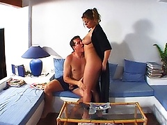 This dissolute mom awakens her sleepy lover by doing him deep passionate blowjob.