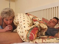 His mother in law wakes him up with a blowjob and it feels so good he fucks her pussy