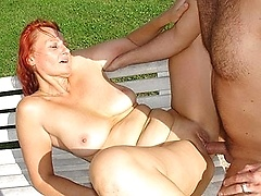 Redheaded housewife is fucked outside in the sun