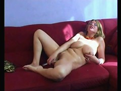 Phat-ass old bitch saddles a huge long rubber rod