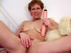 Decent mommy playing dirty with real killer dildo